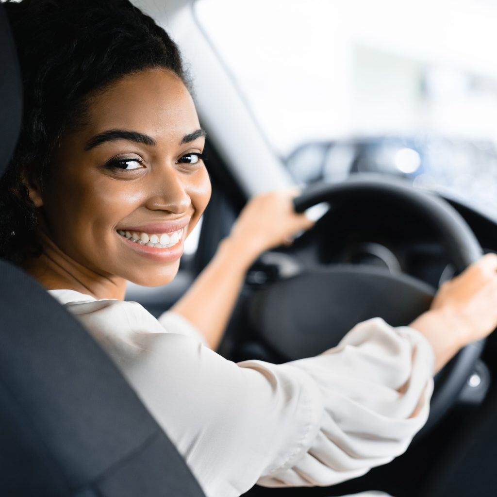 Lundgren Consultants - Woman smiling behind the wheel of car