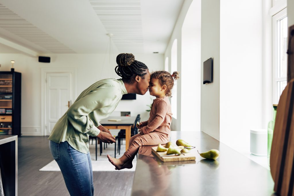 Life Insurance - Mom and child inside home